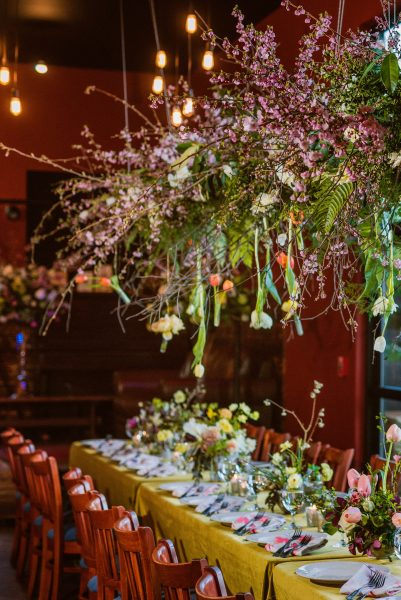 Suspended installation over a head table with Cherry Blossom, ferns and Tulips