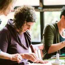 Learning to make wearable flowers at the Whidbey Flower Workshop 2019   image by Suzanne Rothmeyer