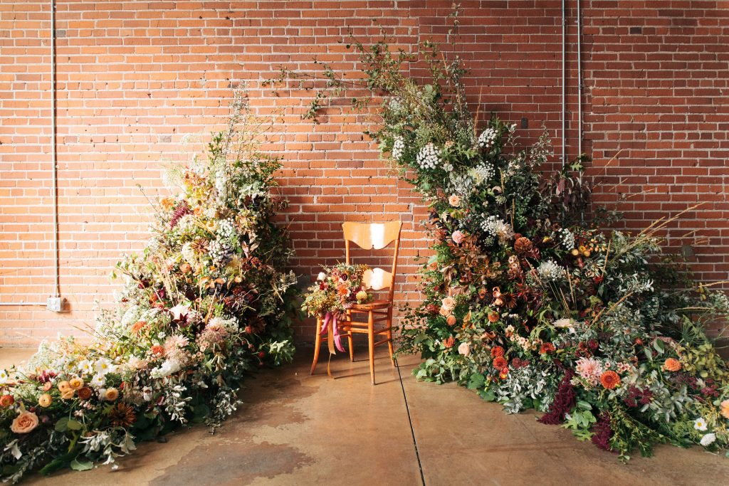 Foam-free asymmetric wedding arch with greenery, blush and caramel tones