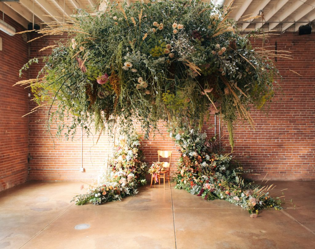 Foam free installations include an asymmetric arch with a meadow and a floral cloud